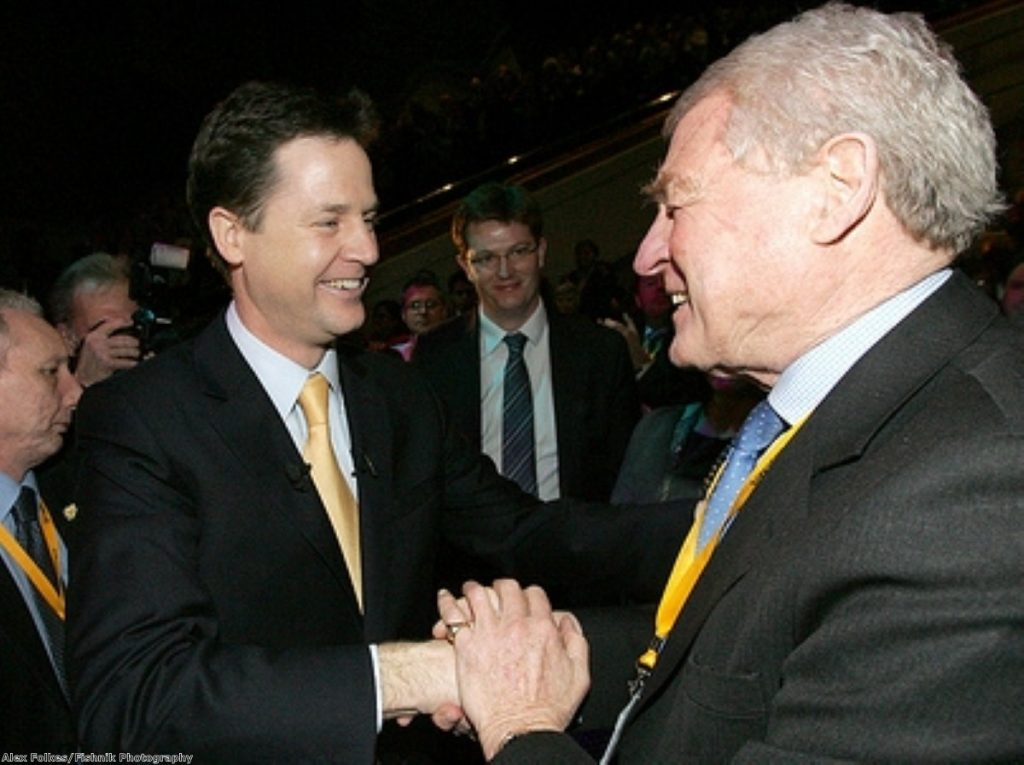 Paddy Ashdown (r) has rallied behind embattled party leader Nick Clegg