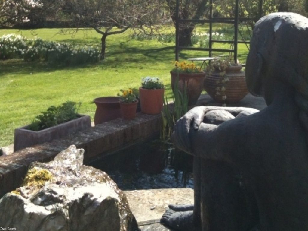 A statue looks over a garden in Hampshire, near Romsey