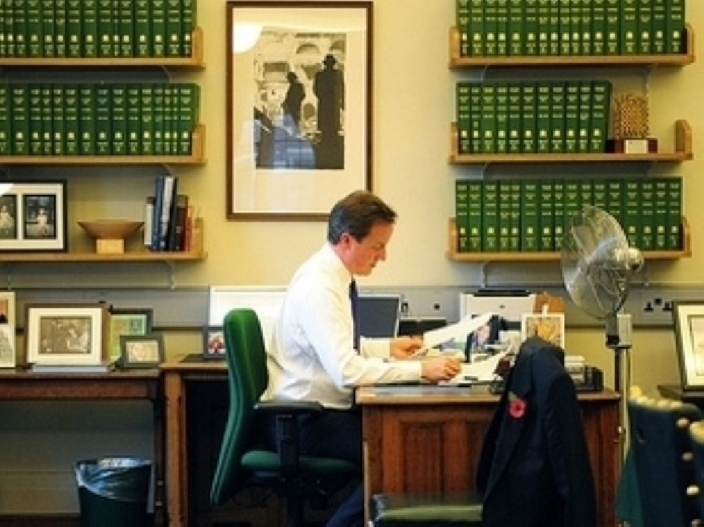 David Cameron in his parliamentary office. He'll be meeting the parliamentary party later today.