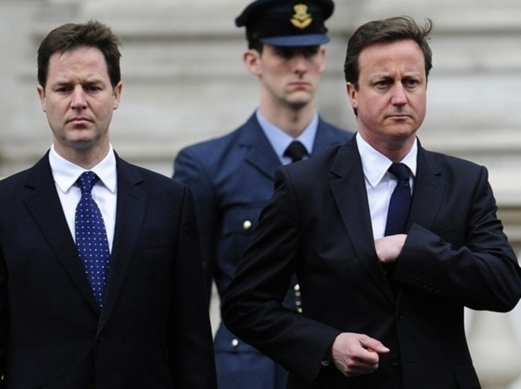 Sour looks: Cameron and Clegg feel the pinch after torrid by-election results