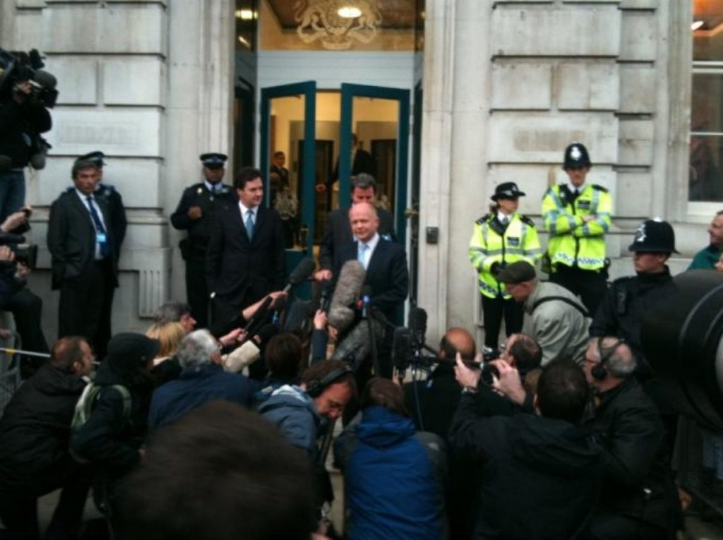 Tory leaders leave the Cabinet Office during coalition negotiations