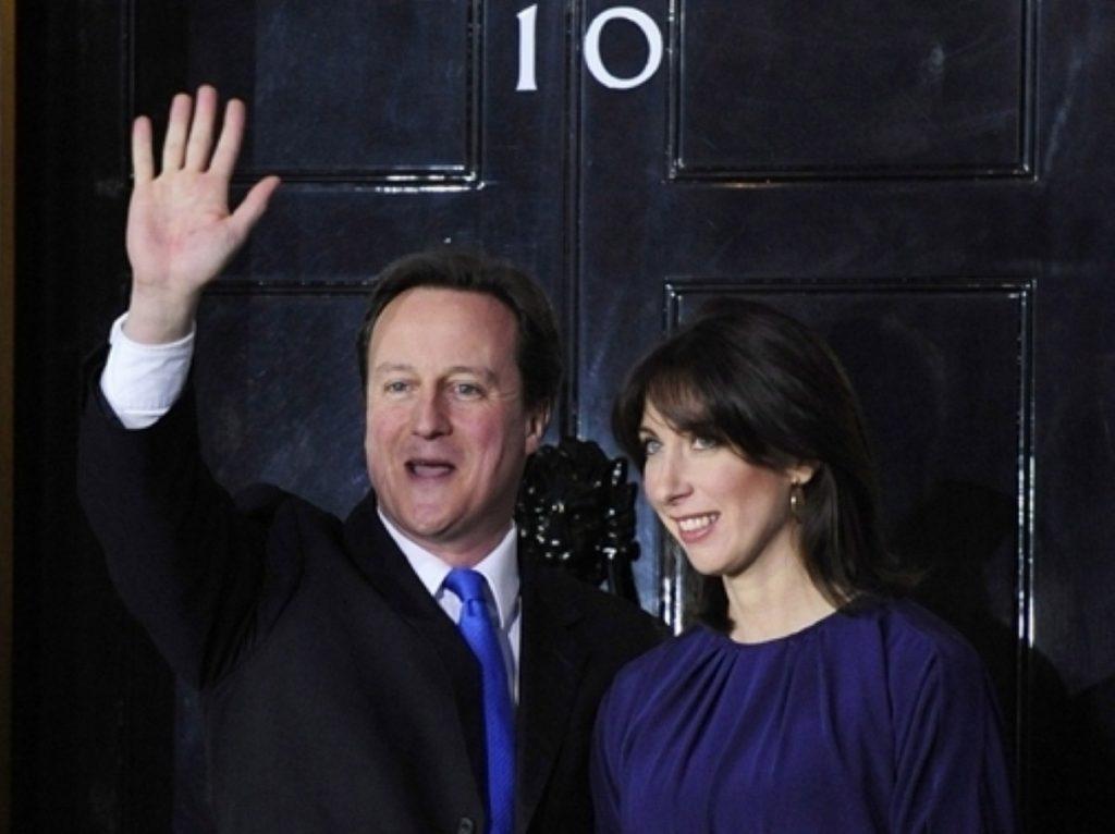 David and Samantha Cameron enter No 10