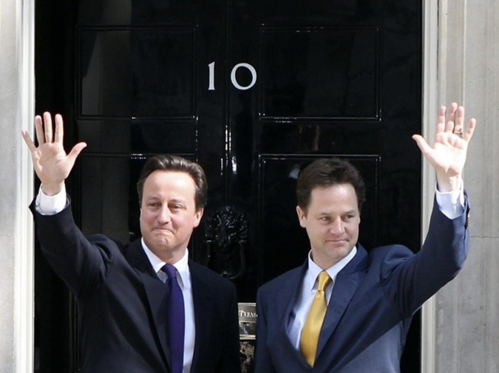 David Cameron and Nick Clegg enter Downing Street together this morning