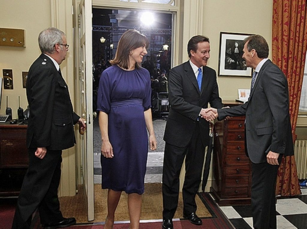Sir Gus O'Donnell (r) welcomes David Cameron into Downing Street