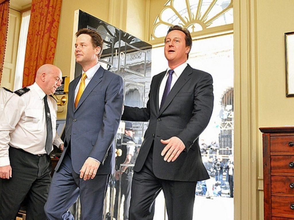 David Cameron welcomes Nick Clegg into No 10