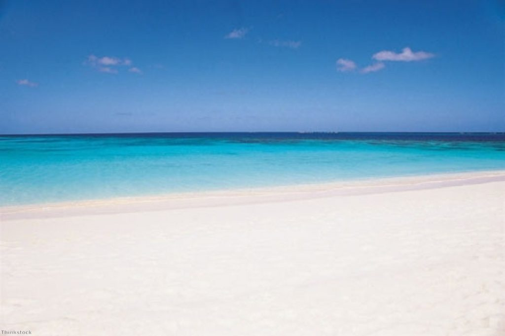 An idyllic beach on Turks and Caicos, where billions of pounds pass through the Islands each year