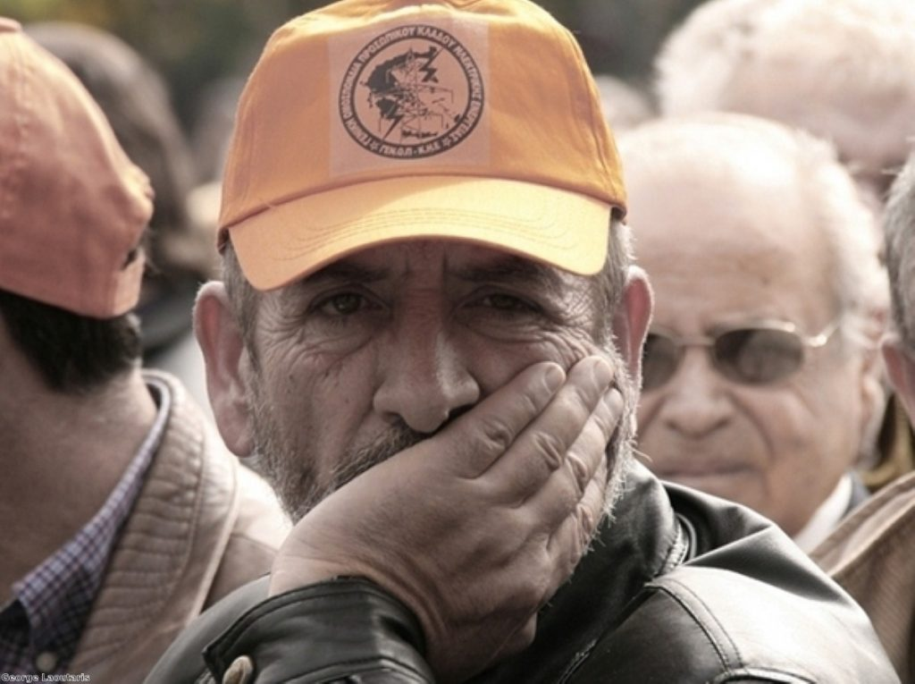 A striker looks on during industrial action in Greece. The Mediterranean country has been the worst hit so far.