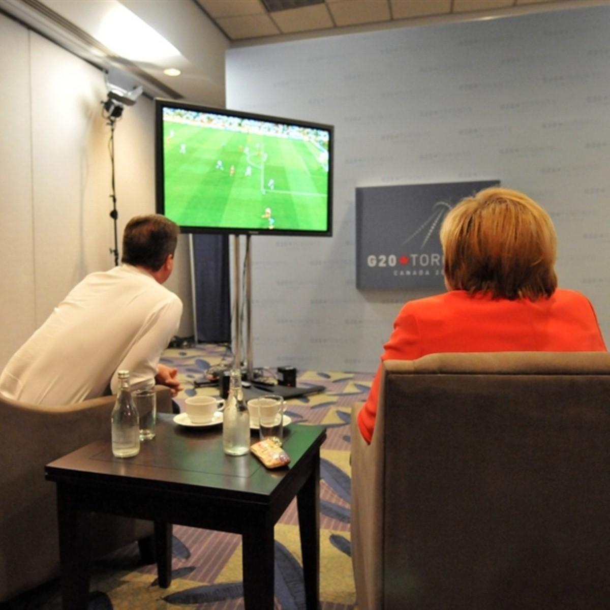 Cameron and Merkel watch England play Germany in the football: The two struck up a friendship over hours of Midsomer Murder