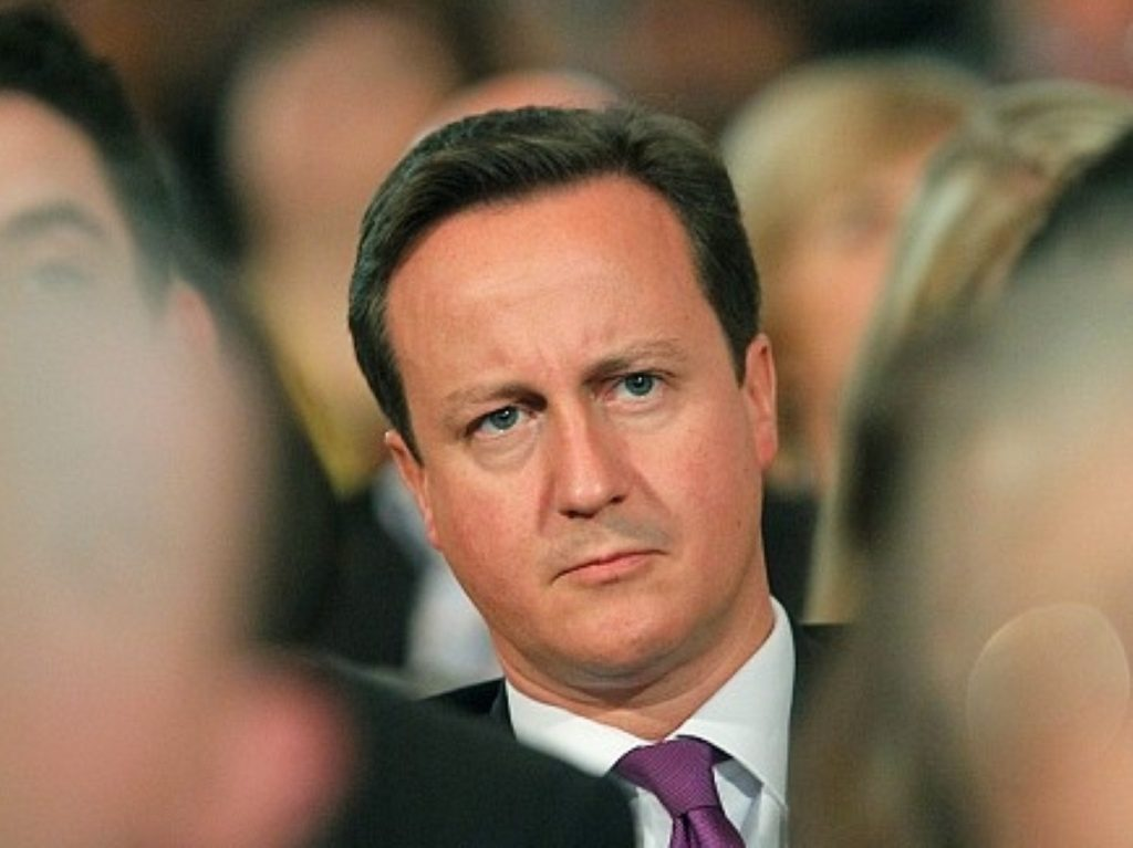 David Cameron among his party members, who want a shift to the right