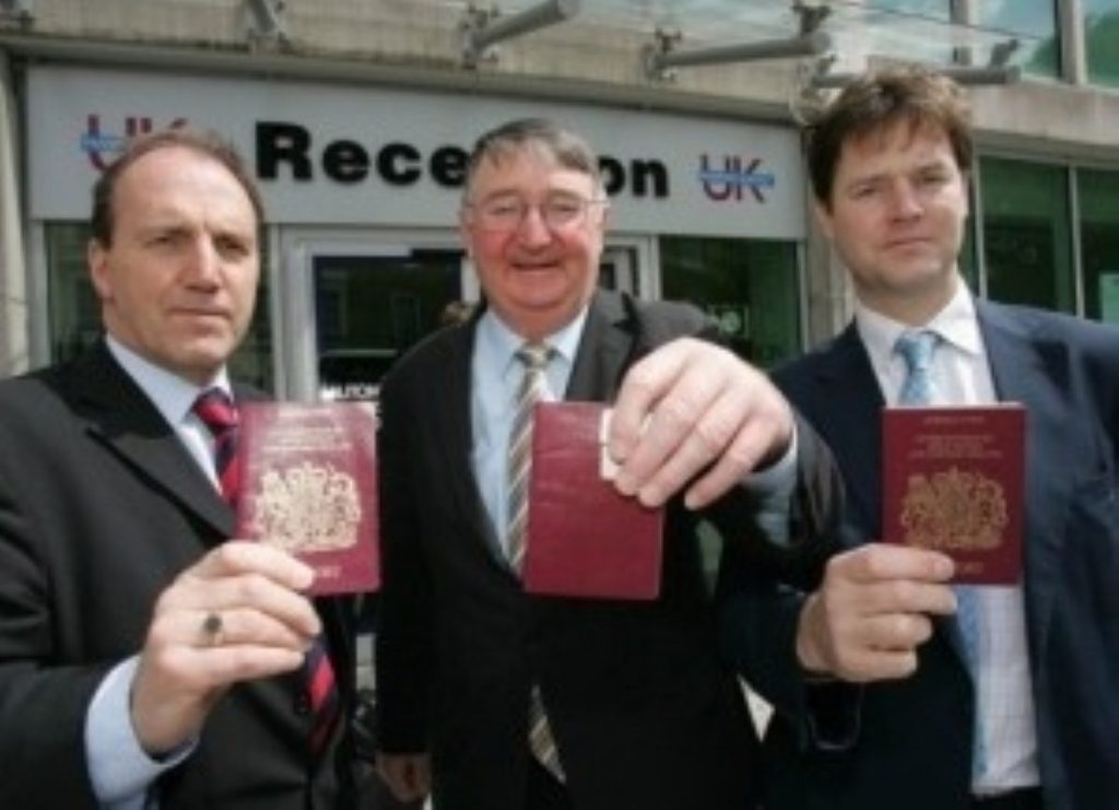 Simon Hughes, Roger Williams and Nick Clegg show their new passports