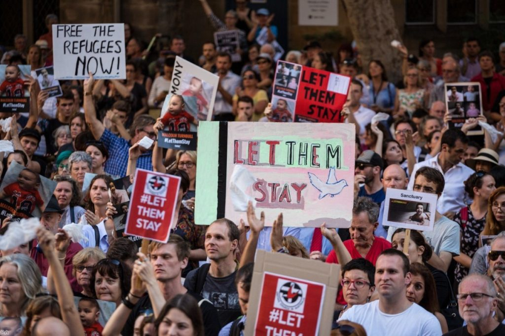 Protests at Sydney Town Hall against the detention of asylum seeker children to the offshore processing centres of Manus Island and Nauru in 2016.