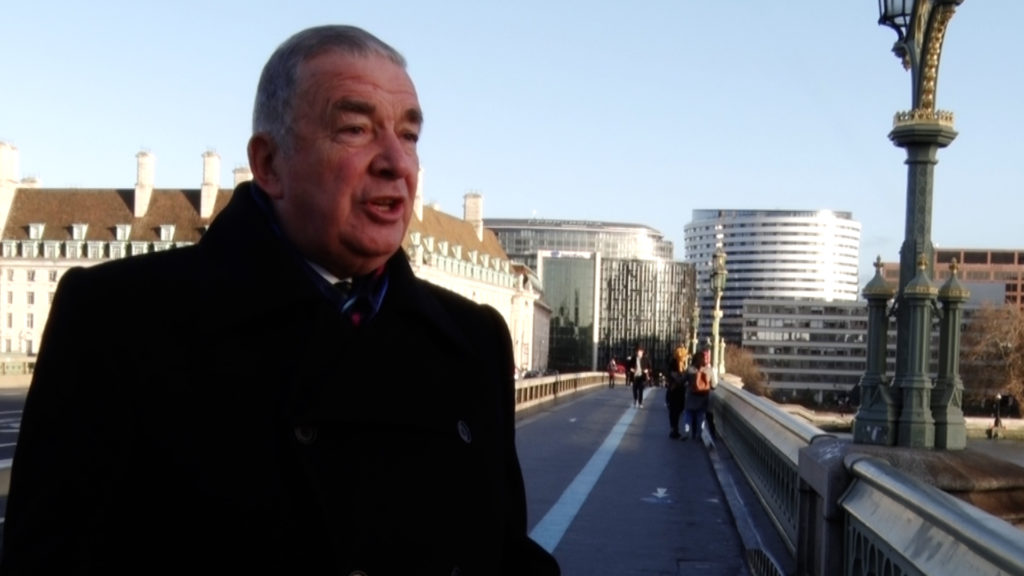 Admiral Lord West standing on London Bridge