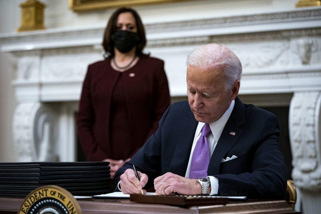US President Joe Biden signs an executive order