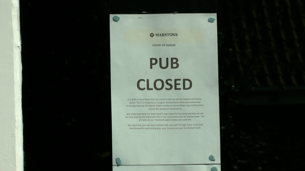 "A notice in a window saying ""PUB CLOSED"""