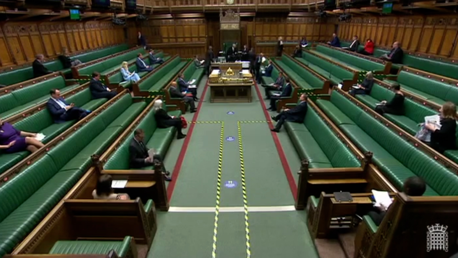 MPs sitting socially distanced in the House of Commons