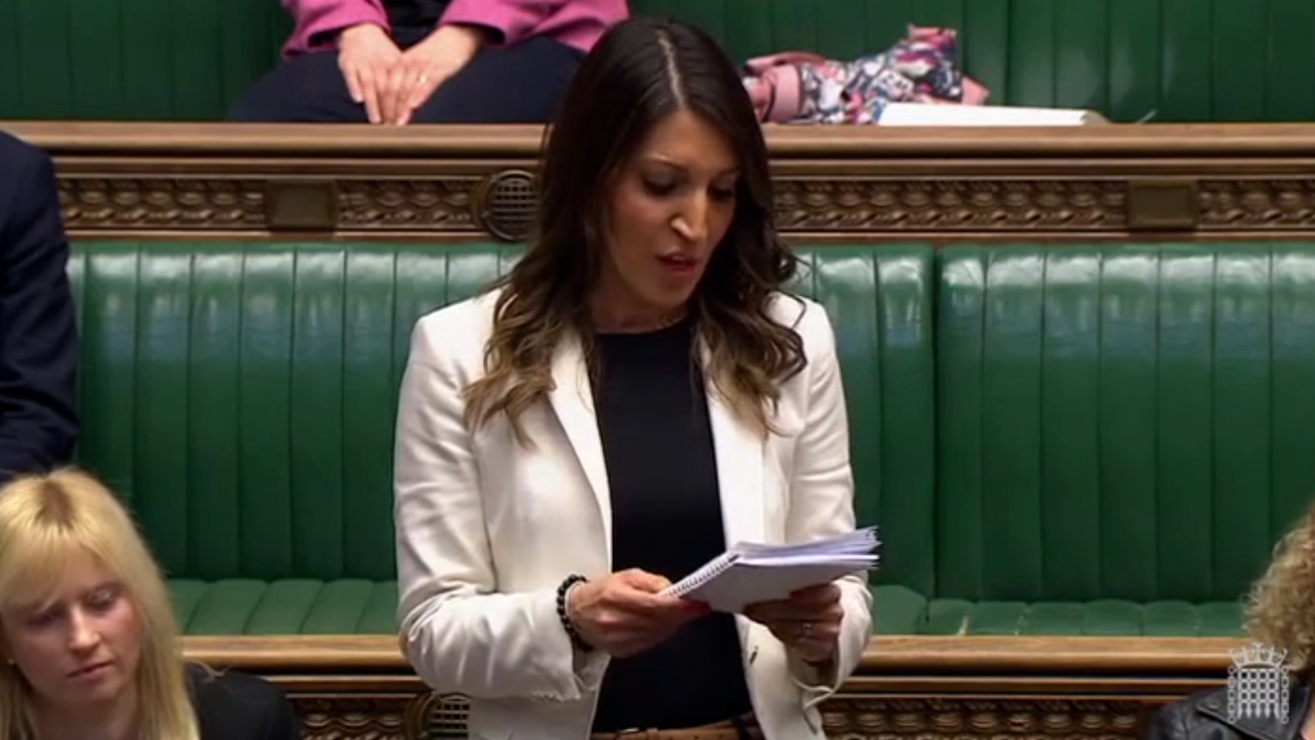 Rosena Allin-Khan looking at notes in the House of Commons