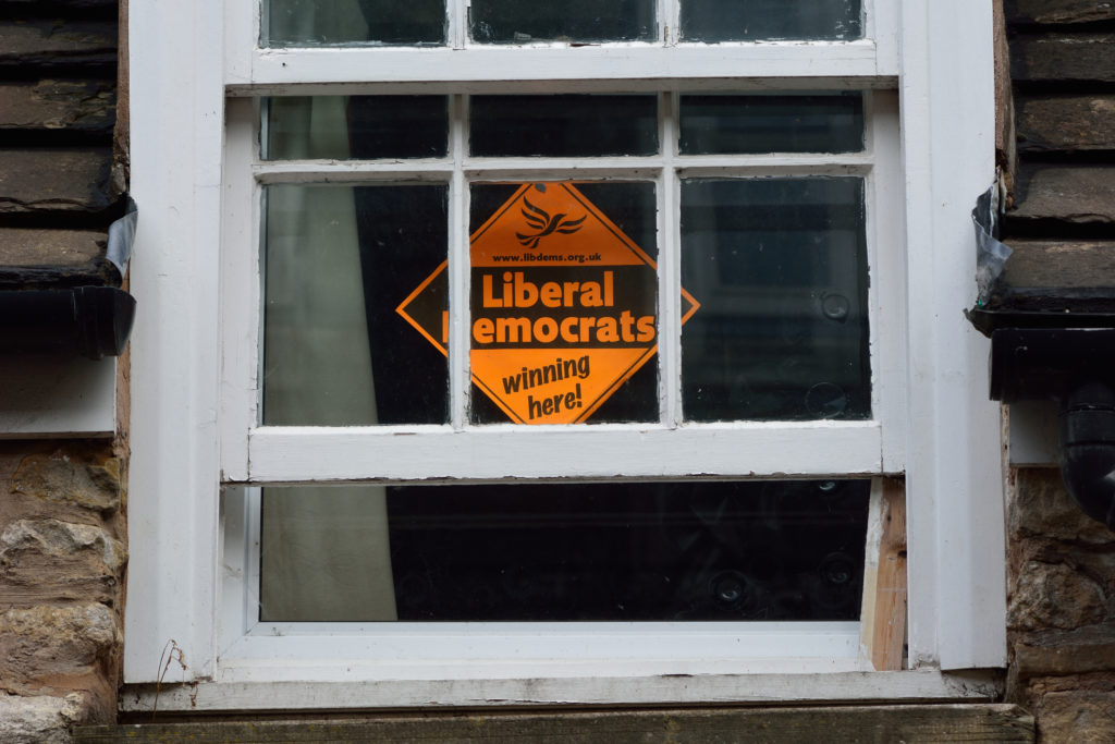 A Liberal Democrat sign in a window