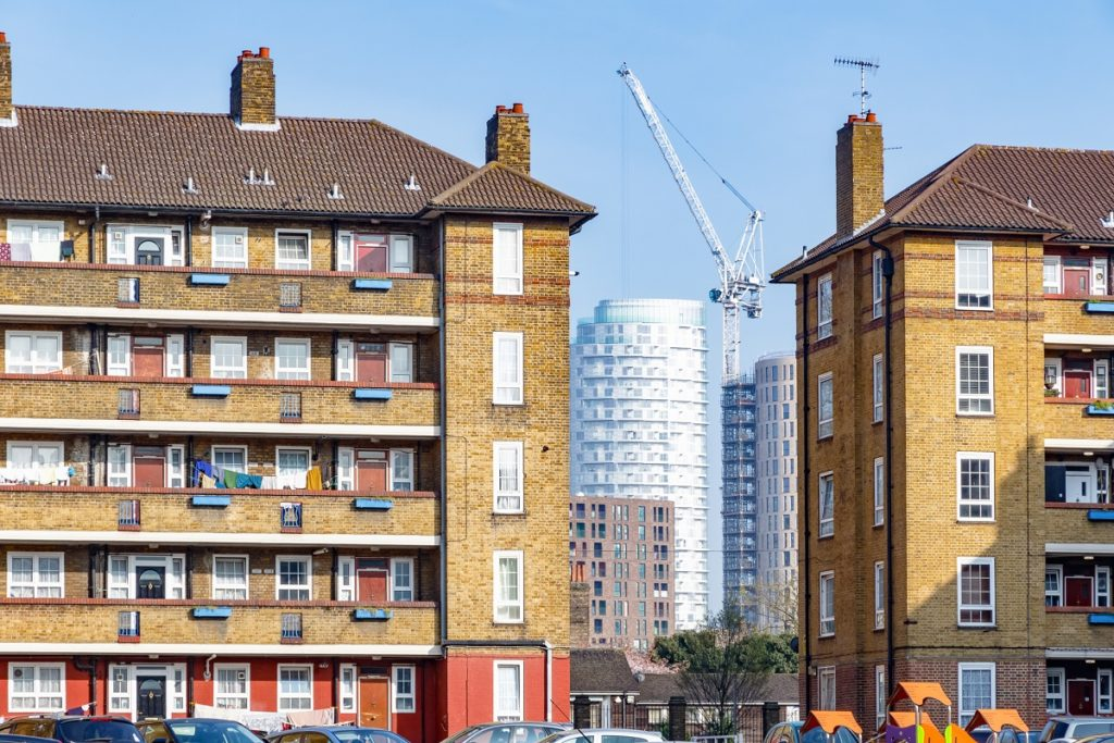 Council housing blocks contrasted with modern high-rise flats
