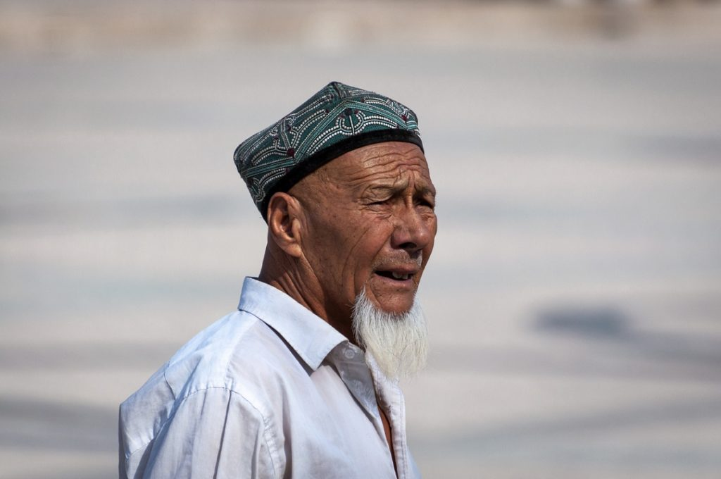 Portrait of a Uyghur man at a street in the city of Kashgar, Xinjiang