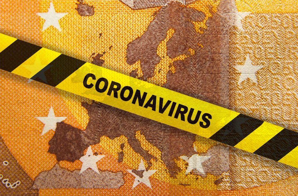 Coronavirus quarantine in Europe. Concept. 50 Euro banknote with EU map and yellow tape.