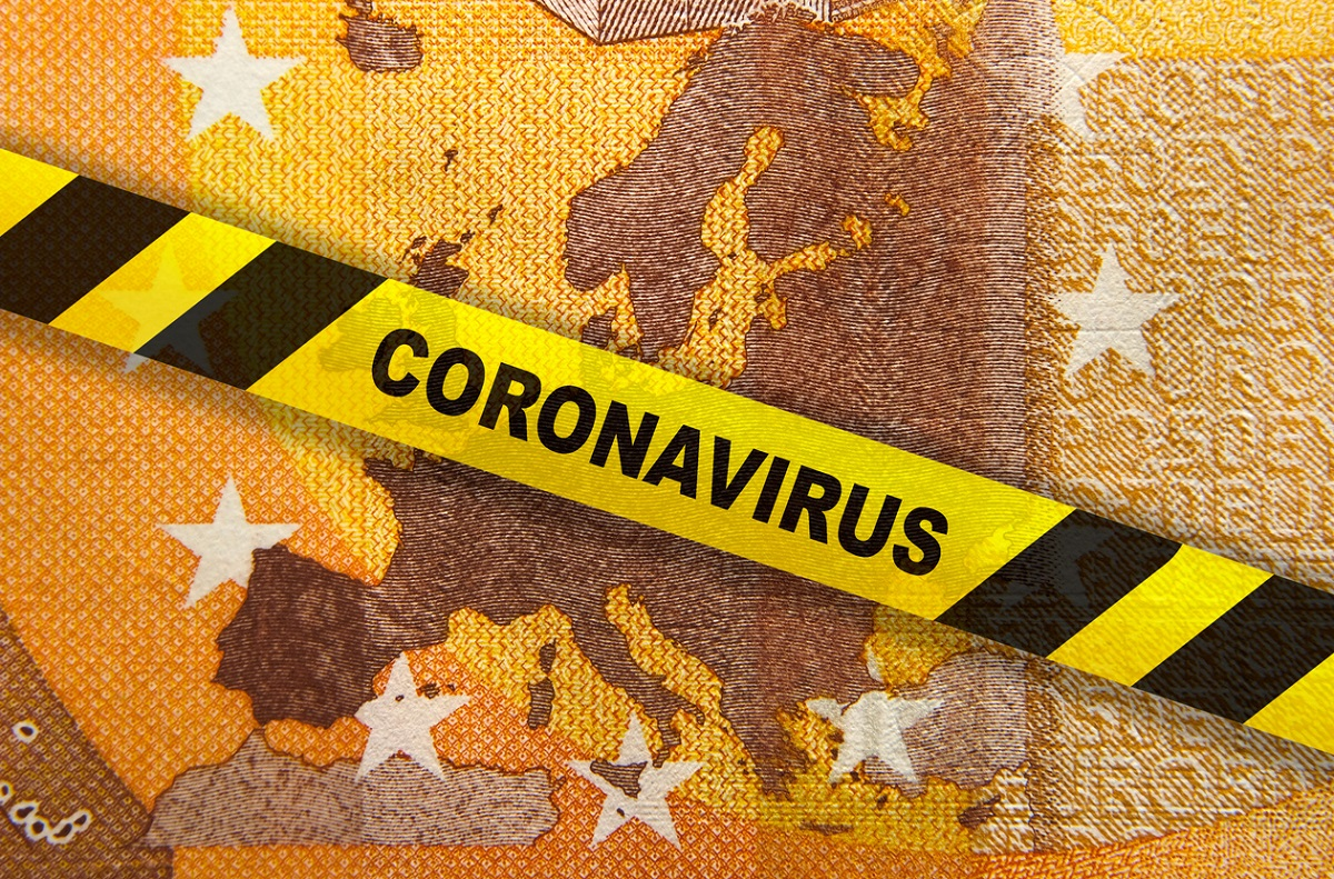 Coronavirus quarantine in Europe. Concept. 50 Euro banknote with EU map and yellow tape.