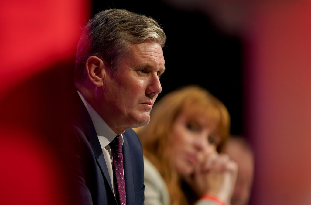Labour leader Sir Keir Starmer and Labour deputy leader Angela Rayner listen as shadow chancellor Rachel Reeves gives her keynote speech at the Labour Party conference at the Brighton Centre. Picture date: Monday September 27, 2021.